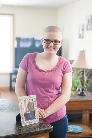 140507 bald for bucks JOED VIERA/STAFF PHOTOGRAPHER-Hartland, NY-12 year old Rachel Hurtgam stands with a photograph of her mother after raising over $1500 and shaving her head for Bald for Bucks. May 7, 2014