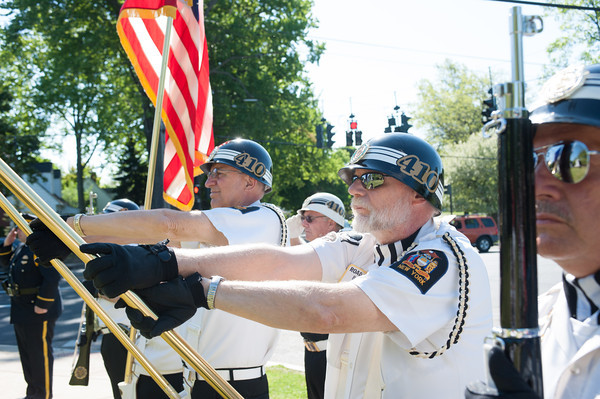 140525 Memorials JOED VIERA/STAFF PHOTOGRAPHER-Lockport, NY- Color Guard Larry Kaczynski holds a flag during a memorial day ceremony at Summit Park, May 25, 2014.