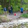 140521 Newfane Water JOED VIERA/STAFF PHOTOGRAPHER-Burt, NY-Newfane High School's Carter Cavagnaro, Olivia Dickenson, Social Studies Teacher Craig Cox and Tyler Jurek test water collected from Eighteen Mile Creek. May 21, 2014