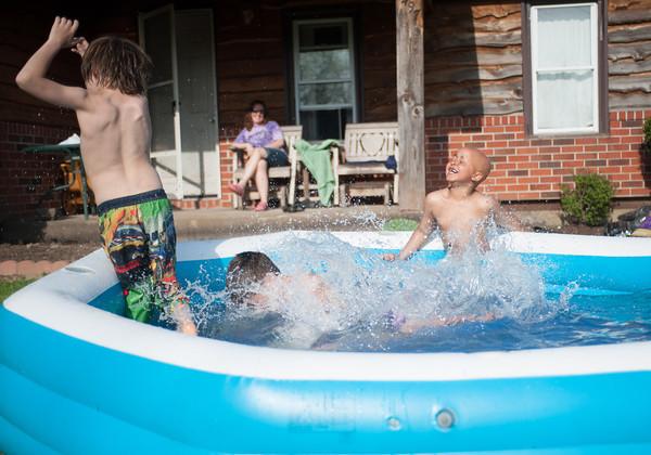 140511 Enterprise JOED VIERA/STAFF PHOTOGRAPHER-Newfane, NY-Zach Kijanka (11) Maison Luna (11) and Jadis Chinn (7) play in a cool swimming pool. May 12, 2014
