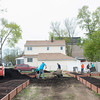 140510 Gardens JOED VIERA/STAFF PHOTOGRAPHER-Lockport, NY-Volunteers help install a new community garden on the corner of Ontario St. and Hawley St. May 10, 2014