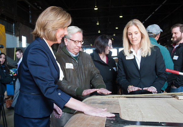 140425 Wooden Lock VIERA/STAFF PHOTOGRAPHER-Tonawanda, NY-Lockport Mayor Anne McCafferey, New York State Assemblyman Robin Schimminger, and New York State Assemblywoman Jane Corwin feel the lock doors being assembled at Hohl's in Tonawanda April 23, 2014.
