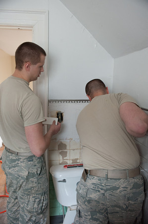 140430 Homeless vet JOED VIERA/STAFF PHOTOGRAPHER-Lockport, NY-Air Force Senior Airmen William Mark and Tech Ronald Tanner patch up a bathroom while renovating the home to be used to house recovering veterans. April 30, 2014