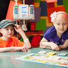 140425 Skyla JOED VIERA/STAFF PHOTOGRAPHER-Buffalo, NY-Skyla Dennis(right) and her friend and fellow patient Triniti Jefferds play a game of Monopoly Jr. in the game room of Roswell Cancer Institute. April 23, 2014.