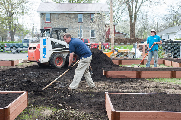 140510 Gardens JOED VIERA/STAFF PHOTOGRAPHER-Lockport, NY-President of the Imagine Community Gardens Bob Zima helps install a new garden on the corner of Ontario St. and Hawley St. May 10, 2014