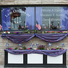 "140523 Purple JOED VIERA/STAFF PHOTOGRAPHER-Lockport NY- the Law offices of Patricia A George are decorated for paint the city purple May 23, 2014. LPT Paint Lockport Purple 052414<br /> Over 30 local businesses decked out their windows and walls with purple decorations for the annual ""Paint the City Purple"" event to promote next month's American Cancer Society Relay for Life. Many shops and businesses decorated with stars and stripes as well to coordinate with the theme of ""Star-Spangled Relay"". Mayor Anne McCaffrey announced ""Paint the City Purple Day"" Friday morning in front of city hall and a panel of five judges scoped out the participants to choose winners. Donna Eick's restaurant won the small business award, First Niagara bank on East Avenue. Tom's Diner won the hospitality award, and the new Canalfront Sandwich shop won the Rookie award."