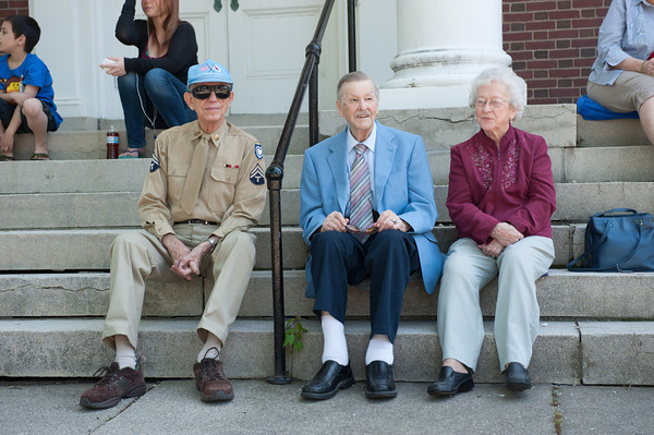 140525 Parade JOED VIERA/STAFF PHOTOGRAPHER-Lockport, NY-Korean War Veteran Don Stopp, Reverend Leland Bowman and his wife Melva Bowman watch the memorial day parade from the steps of the Lockport United Church of Chris May 25, 2014.