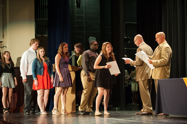 140521 LHS Awards JOED VIERA/STAFF PHOTOGRAPHER-Lockport NY-Brittany Clifford accepts the Lorraine M. and Eugene P. Brady Memorial Scholarship along with the other students line up behind her during the schools senior award ceremony. May 21, 2014