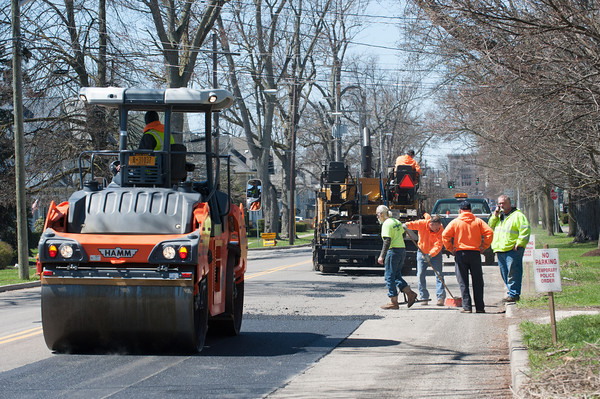 140424 Enterprise VIERA/STAFF PHOTOGRAPHER-Lockport, NY-City Workers patch up potholes on East Ave April 24, 2014.