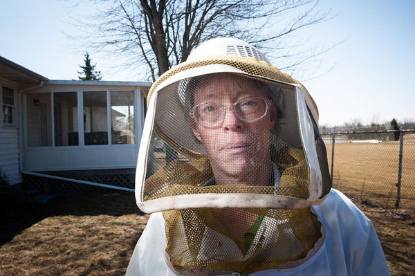 140404 Slideshow JOED VIERA/STAFF PHOTOGRAPHER Lockport, NY-Geri Hens stands in her bee keeper suit at one of her colony sites April 2, 2014.
