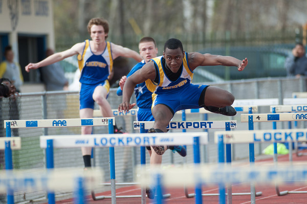 140501 LHS Track JOED VIERA/STAFF PHOTOGRAPHER-Lockport, NY-Maurice Channer jumps hurdles during Lockport High schools track meet against Kenmore West. Channer finished in first place. April 30, 2014
