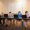 140510 Game maker JOED VIERA/STAFF PHOTOGRAPHER-Lockport, NY-Evan Wirth, Jacob Sehnure, Jordan Hausler and Julie-Ann Hausler  pay attention while attending a class on game devolopment at the Lockport Public Library. May 10, 2014