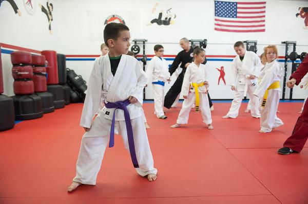 140424 Self Defense VIERA/STAFF PHOTOGRAPHER-Lockport, NY-Caden Cordero follows orders during a self defense class April 24, 2014.