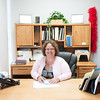 140512 Salvation Army JOED VIERA/STAFF PHOTOGRAPHER-Lockport, NY-Mental Health Association in Niagara County Director Cheryl Blacklock sits at her desk. May 7, 2014