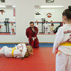 140424 Self Defense VIERA/STAFF PHOTOGRAPHER-Lockport, NY-Gynealiz Collazo(right) watches as Tom Hillman(red gi) directs Sarah Hahn(blonde) and Jenna Polito(yellowbelt) during thier self defense class April 24, 2014.