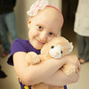 140425 Skyla JOED VIERA/STAFF PHOTOGRAPHER-Buffalo, NY-Skyla Dennis hugs one of her stuffed animals at Roswell Cancer Institute. April 23, 2014.