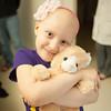 140425 Skyla JOED VIERA/STAFF PHOTOGRAPHER-Buffalo, NY-Skyla Dennis hugs one of her stuffed animals at Roswell Cancer Institute. April 23, 2014.