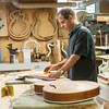 140515 Guitar Maker JOED VIERA/STAFF PHOTOGRAPHER-Lancaster, NY-Charles Paddock a retired toymaker turned guitar and banjo crafter carves  an archtop jazz guitarin his workshop. May 13, 2014