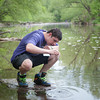 140521 Newfane Water JOED VIERA/STAFF PHOTOGRAPHER-Burt, NY-Dakota Spellan collects a sample of water to test from Eighteen Mile Creek. May 21, 2014