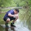 140521 Newfane Water JOED VIERA/STAFF PHOTOGRAPHER-Burt, NY-Dakota Spellan collects a sample of water to test from Eighteen Mile Creek. May 21, 2014