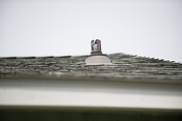 140507 Bathroom JOED VIERA/STAFF PHOTOGRAPHER-Lockport, NY-A soda can used as a vent cover rests atop the Schuman's roof. May 7, 2014