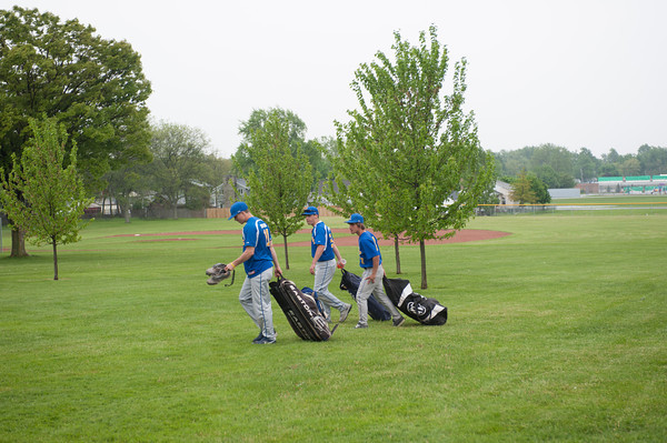 140527 canceled baseball JOED VIERA/STAFF PHOTOGRAPHER-Lockport, NY-Lockport High School baseball players walk back to thier cars with packed bags after another rained out game May 27, 2014.