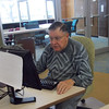HOWARD BALABAN/STAFF<br /> Richard Turoski checks his stock portfolio on a Lee-Whedon Memorial Library. The retired Air Force lieutenant colonel earned an investment advisory license after leaving military service.