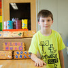 140422 Starpoint craft JOED VIERA/STAFF PHOTOGRAPHER-Lockport, NY-Starpoint 4th grader Dylan wokeoda 10 stands next to  crafts he made to sell at the the event April 22, 2014.