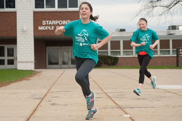 140425 Girls on a Run JOED VIERA/STAFF PHOTOGRAPHER-Pendleton, NY- Starpoint 6th graders Haleigh balko (11) and Jenna Bull (11,right) train for a 5km event. April 25, 2014.
