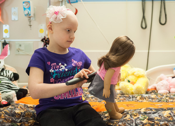140425 Skyla JOED VIERA/STAFF PHOTOGRAPHER-Buffalo, NY-Skyla Dennis brushes her doll's hair at Roswell Cancer Institute. April 23, 2014.