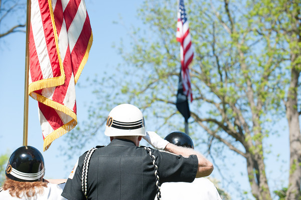 140525 Memorials JOED VIERA/STAFF PHOTOGRAPHER-Lockport, NY- The Color Guard's Bill Burnett salutes the flag during a memorial day ceremony at Veterans Park, May 25, 2014.