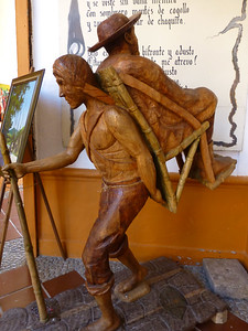 "Carving of an original ""Silletero"" - transporting elderly or disabled people by carrying them in chairs (sillas) on their backs."