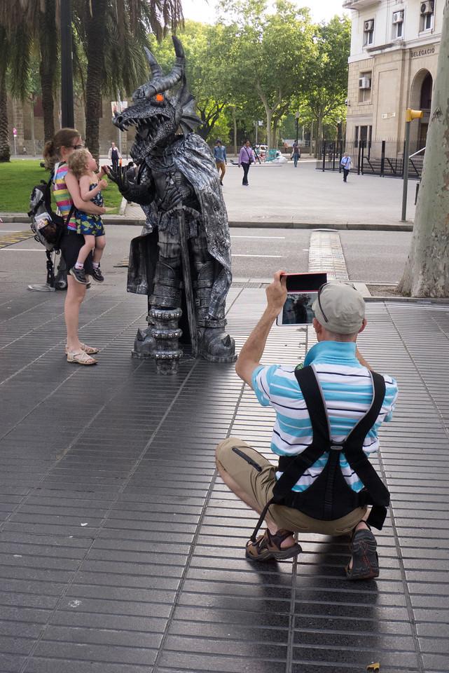 Tourist family with human statue on La Rambla