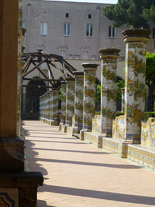 Santa Chiara Cloister (14th century) with 18th century frescos and wonderful tile pillars and scenes, added 1742-1768.