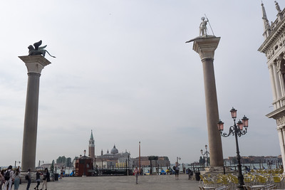 Towers of San Marco (left, the winged lion) and St. Theodore (right, with slain dragon), patrons of Venice. St. Theodore was the patron saint early on until some industrious Venetian merchants stole the remains of St. Mark from Alexandria and brought him to Venice to be the new patron saint in 828 A.D.