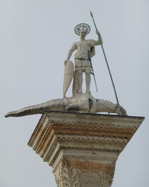 St. Theodore on his column with his crocodile.