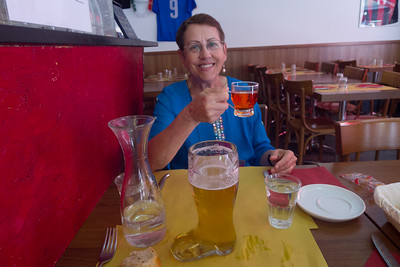 Lois was surprised at the strength of the hot punch she ordered with her lunch of shellfish and couscous. She finished it off without too much trouble, though; I certainly had no trouble finishing my bootful of beer.