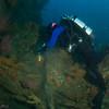 Janet cuts away a ghost net, Pedestal Rock