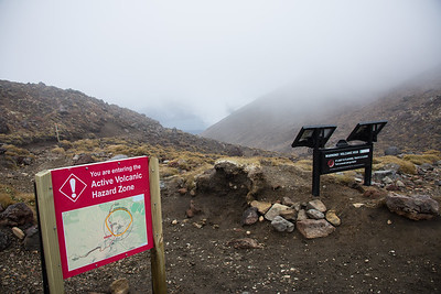 Not your usual trail signs.  If the sign on the right is flashing, it means the volcano is erupting!  Turn around!