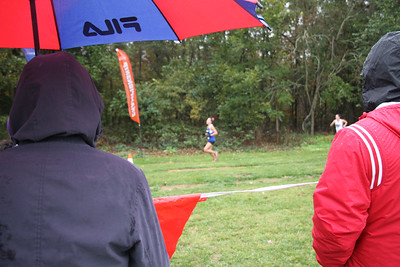 Fans stand in the rain as they watch the Big South Cross Country Championship