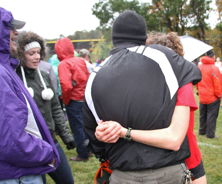 Gabrielle Cortese talks to family and friends after finishing her race at the Big South Championship.