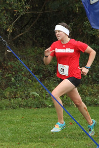 Rachel White crosses the finish line at the Big South Championship.