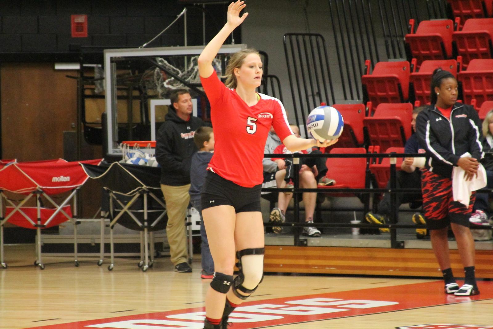 5, Sydney Marshall serves the ball.