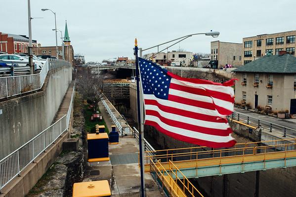 JOED VIERA/STAFF PHOTOGRAPHER-Lockport, NY-Old glory picks up the wind over the Locks. Tuesday, November, 25 2014.