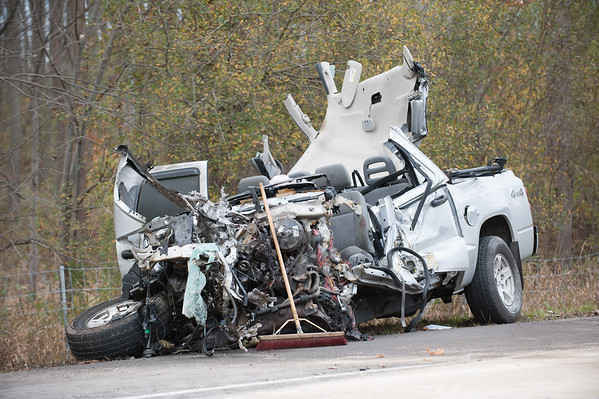 JOED VIERA/STAFF PHOTOGRAPHER-Lockport, NY- A clean up crews broom lays on the remains of a pick-up involved in a crash with a semi. Monday, November, 3 2014.