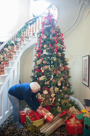 JOED VIERA/STAFF PHOTOGRAPHER-Lockport, NY-Kathy Greenfield  decorates a tree in the Kenan Art Center. Saturday, November, 15 2014.