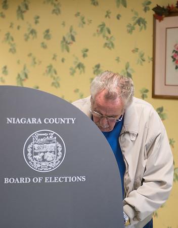 JOED VIERA/STAFF PHOTOGRAPHER-Lockport, NY-Gary Brockman fills out his ballot at  Briarwood Manor. Tuesday, November, 4 2014.