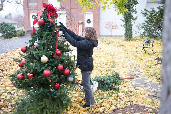 JOED VIERA/STAFF PHOTOGRAPHER-Lockport, NY-Donna Barton decorates a tree outside the Kenan Art Center. Saturday, November, 15 2014.