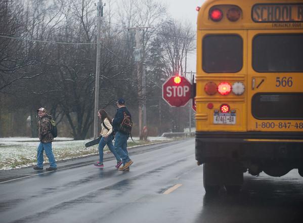 JOED VIERA/STAFF PHOTOGRAPHER-Lockport, NY-Students cross a snowy and wet Robinson Road. Monday, November, 17 2014.
