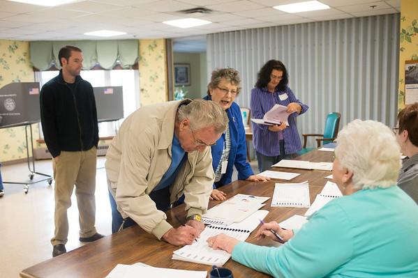 JOED VIERA/STAFF PHOTOGRAPHER-Lockport, NY-Gary Brockman checks in to vote at the Briarwood  Manor. Tuesday, November, 4 2014.